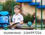 cute little schoolboy studying... | Shutterstock . vector #1164597226
