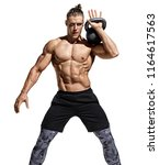 muscular man training with... | Shutterstock . vector #1164617563