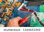 disposal of electronic waste.... | Shutterstock . vector #1164651343