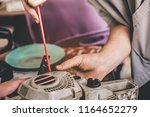 mechanic working with old... | Shutterstock . vector #1164652279