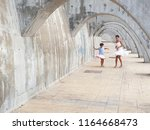 funny mother and daughter... | Shutterstock . vector #1164668473