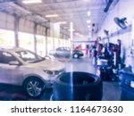 vintage tone blurred motion... | Shutterstock . vector #1164673630