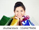 portrait of beautiful happy... | Shutterstock . vector #1164679606
