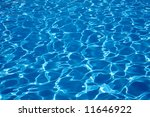 The Sun reflected in the water of the swimming pool. - stock photo