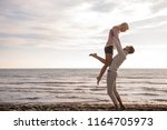 young couple having fun walking ... | Shutterstock . vector #1164705973