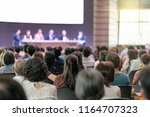 rear view of audience in the... | Shutterstock . vector #1164707323