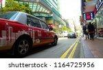 hong kong red taxi driving  ...   Shutterstock . vector #1164725956