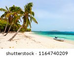idyllic tropical beach with... | Shutterstock . vector #1164740209