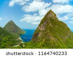 iconic view of piton mountains... | Shutterstock . vector #1164740233