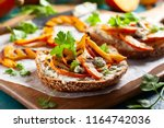 open sandwich with grilled... | Shutterstock . vector #1164742036