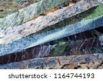 a stack of multi colored marble ... | Shutterstock . vector #1164744193