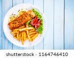 fried salmon  french fries and... | Shutterstock . vector #1164746410