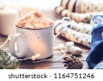 hot cocoa with marshmallow in a ... | Shutterstock . vector #1164751246