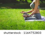 fitness asian woman doing yoga... | Shutterstock . vector #1164752803