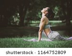 fitness asian woman doing yoga... | Shutterstock . vector #1164752809