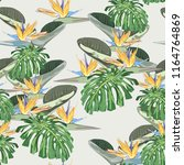 bright tropical leaves with... | Shutterstock .eps vector #1164764869
