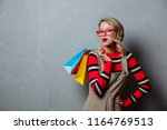 young style girl with shopping... | Shutterstock . vector #1164769513
