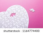 White Puzzle Heart On Pink...