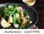 Close up of organic potato salad with green vegetables and mustard dressing. styled by food stylist - stock photo