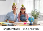 funny mother and child daughter ... | Shutterstock . vector #1164781909