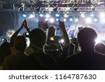 silhouettes of crowd at concert ...   Shutterstock . vector #1164787630