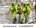 rescuers in protective suits...   Shutterstock . vector #1164808099