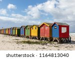 beach houses in primary colours ... | Shutterstock . vector #1164813040