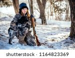 girl hunter with binoculars in... | Shutterstock . vector #1164823369
