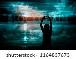 silhouette of woman hands in... | Shutterstock . vector #1164837673