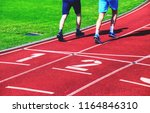 male athletes are running on... | Shutterstock . vector #1164846310