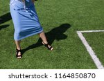girl's legs in shoes and a blue ...   Shutterstock . vector #1164850870