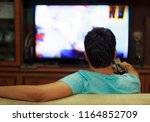 male watching television in... | Shutterstock . vector #1164852709
