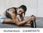 female athlete doing stretching ... | Shutterstock . vector #1164855070