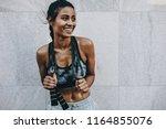 female athlete in fitness... | Shutterstock . vector #1164855076