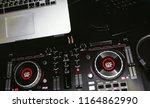 overhead top shot of dj... | Shutterstock . vector #1164862990