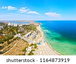 a sea city with a beach and a... | Shutterstock . vector #1164873919