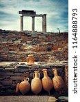 historical ruins in delos... | Shutterstock . vector #1164888793