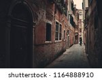 alley view with historical... | Shutterstock . vector #1164888910