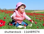 Baby Girl Sitting In A Poppies...