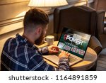 young man playing poker via... | Shutterstock . vector #1164891859