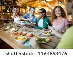 happy young intercultural... | Shutterstock . vector #1164893476