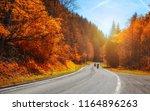 bikers on mountainous highway ... | Shutterstock . vector #1164896263
