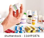 hand holding remedy.  medicine. | Shutterstock . vector #116491876