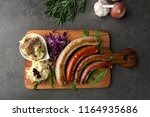 grilled sausages on wooden... | Shutterstock . vector #1164935686