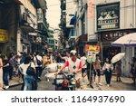 aug 27  2018  macau  crowd of... | Shutterstock . vector #1164937690