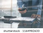 business man or accountant... | Shutterstock . vector #1164982633