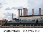 the high chimneys of an old... | Shutterstock . vector #1164989410