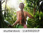 portrait of nice young woman is ... | Shutterstock . vector #1165002019