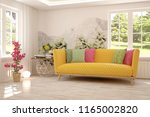 white room with sofa and green... | Shutterstock . vector #1165002820