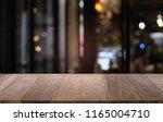 empty dark wooden table in...   Shutterstock . vector #1165004710